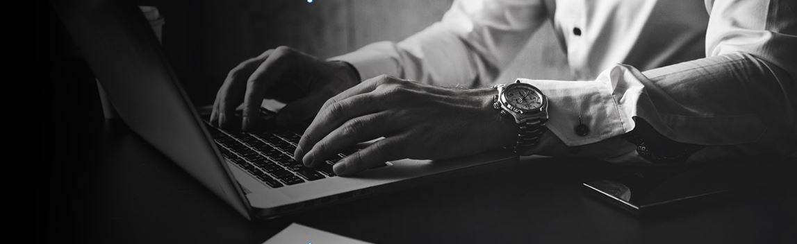 Man writing a blog on a laptop