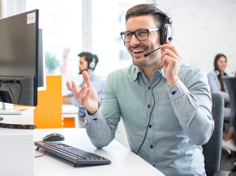 Young male support tech speaking to a client on a headset